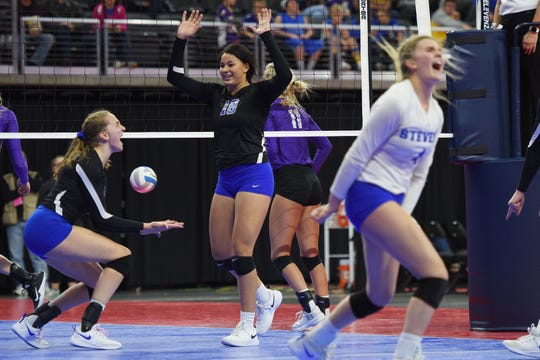 RC Stevens' Kyah Watson (18) celebrates with her team during the game against Watertown during the semifinals Friday, Nov. 16, at the Denny Sanford Premier Center in Sioux Falls.
