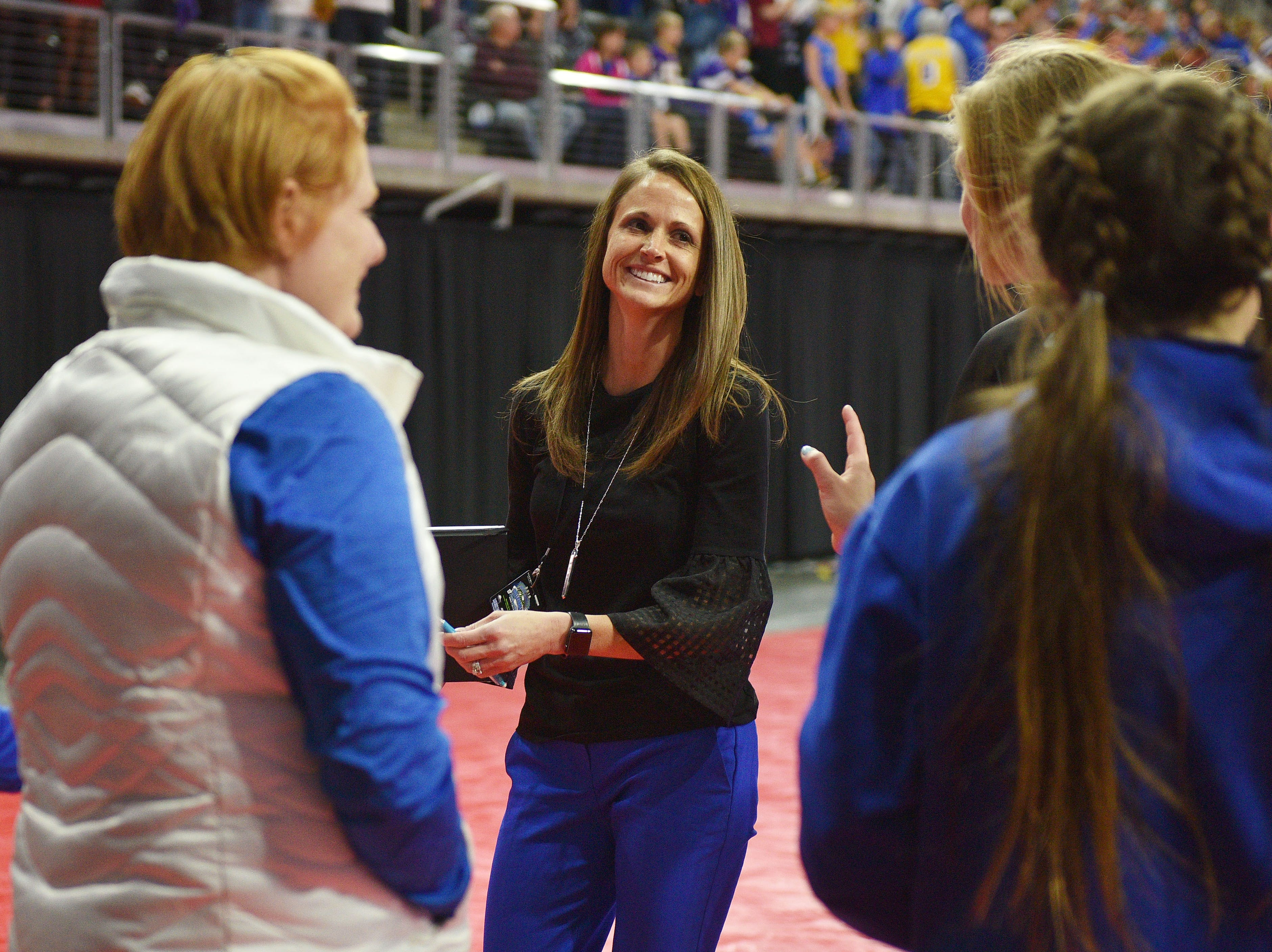 RC Stevens' head coach Kylie Voorhees walks off the court after a win against Watertown during the semifinals Friday, Nov. 16, at the Denny Sanford Premier Center in Sioux Falls.