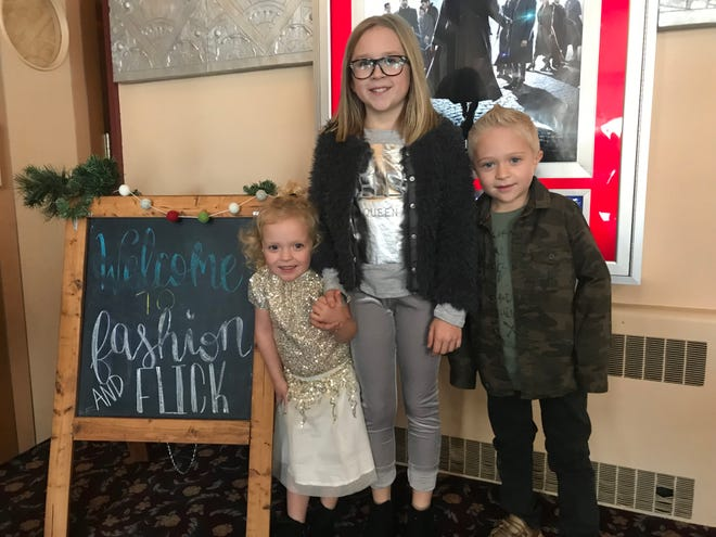 Left to right: Lucy, Cali and Hudson Jamison get ready to model at the Fashion and Flick event at Dells Theatre on Saturday, Nov. 17.