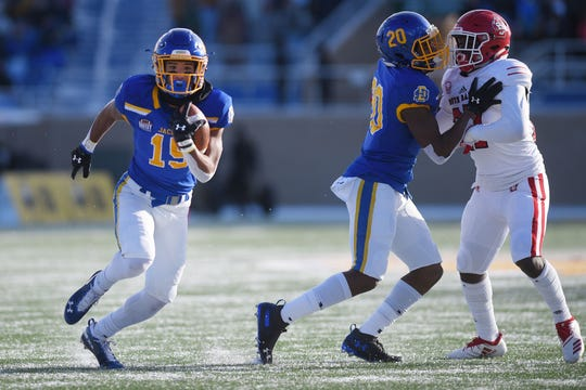 SDSU's Cade Johnson, left, runs the ball during the game against USD Saturday, Nov. 17, at Dana Dykhouse Stadium stadium in Brookings.