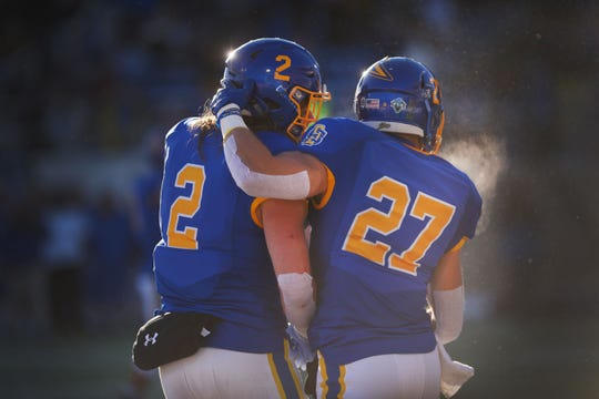 SDSU's Christian Rozeboom (2) and Brandon Snyder (27) celebrate in the end zone during the game against USD Saturday, Nov. 17, at Dana Dykhouse Stadium stadium in Brookings.