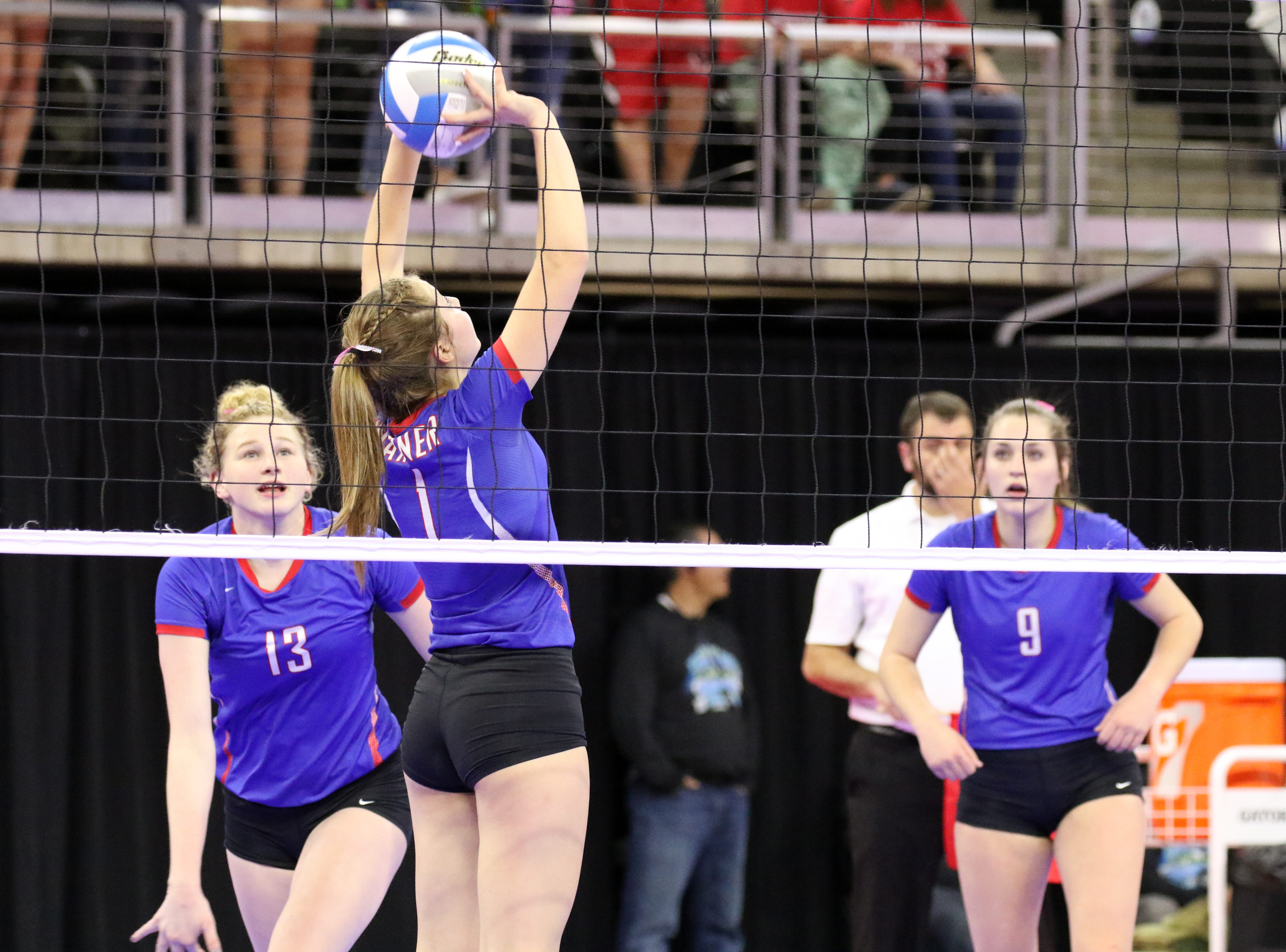 Peyton Fischer of Warner sets the ball for Laurie Rogers (13) during the Class B semifinals match against Chester Area on Friday in Sioux Falls.