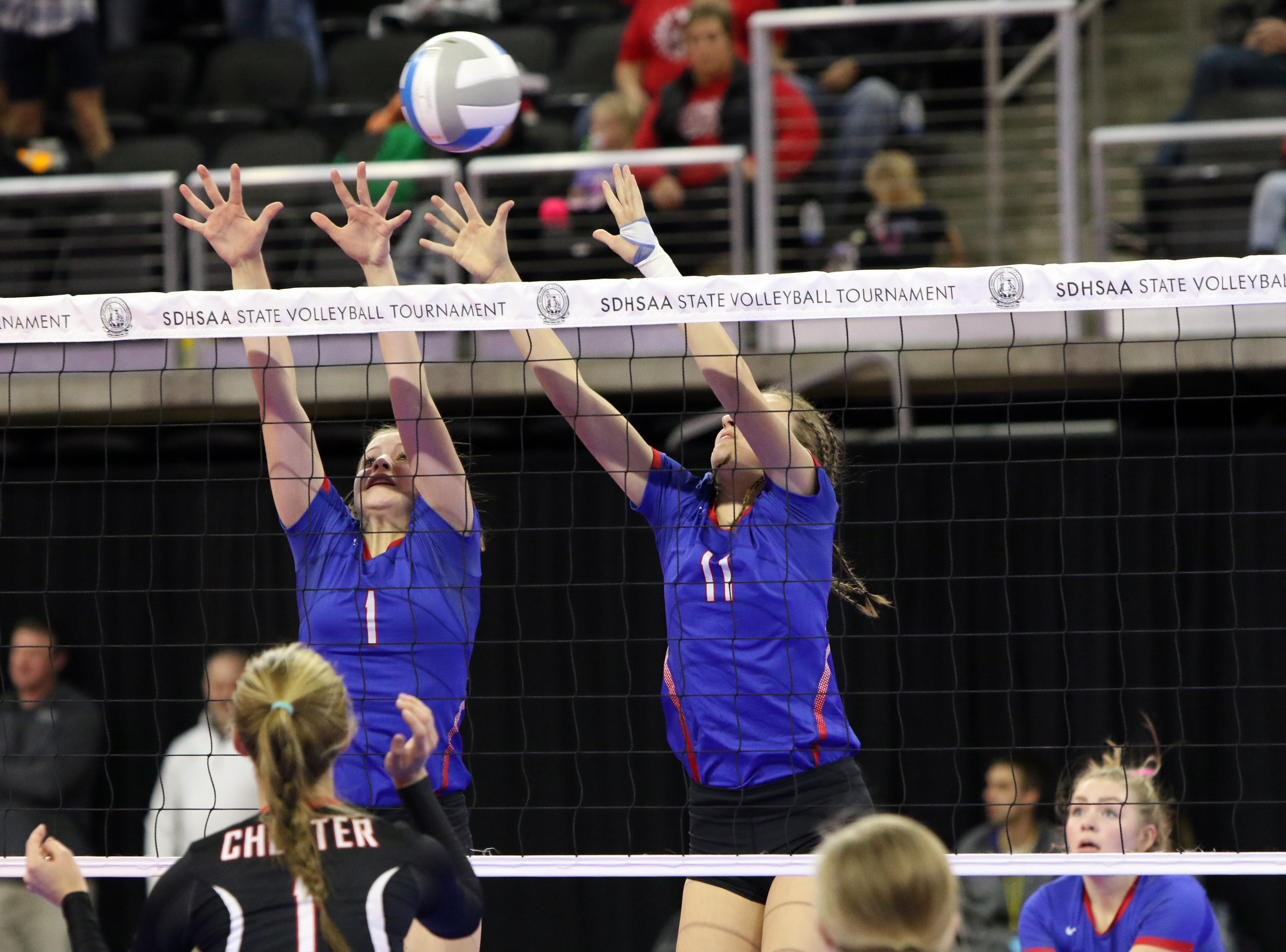 Peyton Fischer (1) and Danille Seymour (11) of Warner go up to block a shot during Friday's Class B semifinal against Chester Area in Sioux Falls.