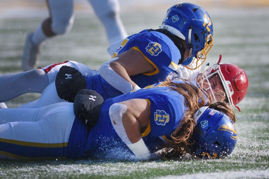 USD's Austin Simmons is taken down by SDSU defense during the game Saturday, Nov. 17, at Dana Dykhouse Stadium stadium in Brookings.
