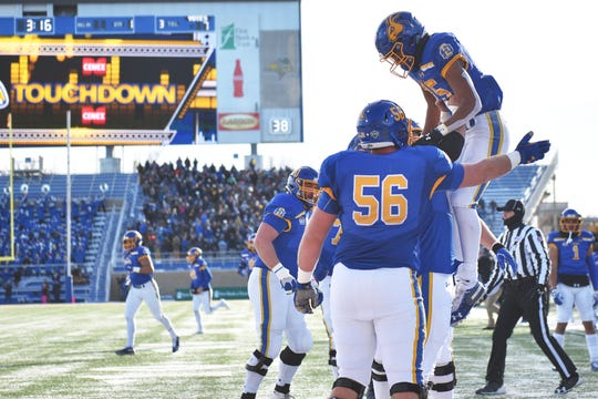 SDSU's Cade Johnson celebrates in the end zone during the game against USD Saturday, Nov. 17, at Dana Dykhouse Stadium stadium in Brookings.