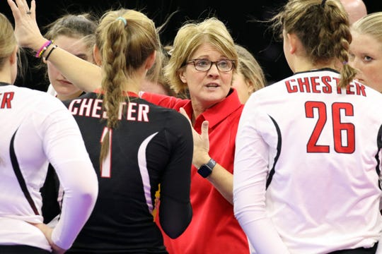 Chester Area head coach, Jean Benson talks with her team during a timeout in their match with Warner during the Class B semifinals on Friday in Sioux Falls.