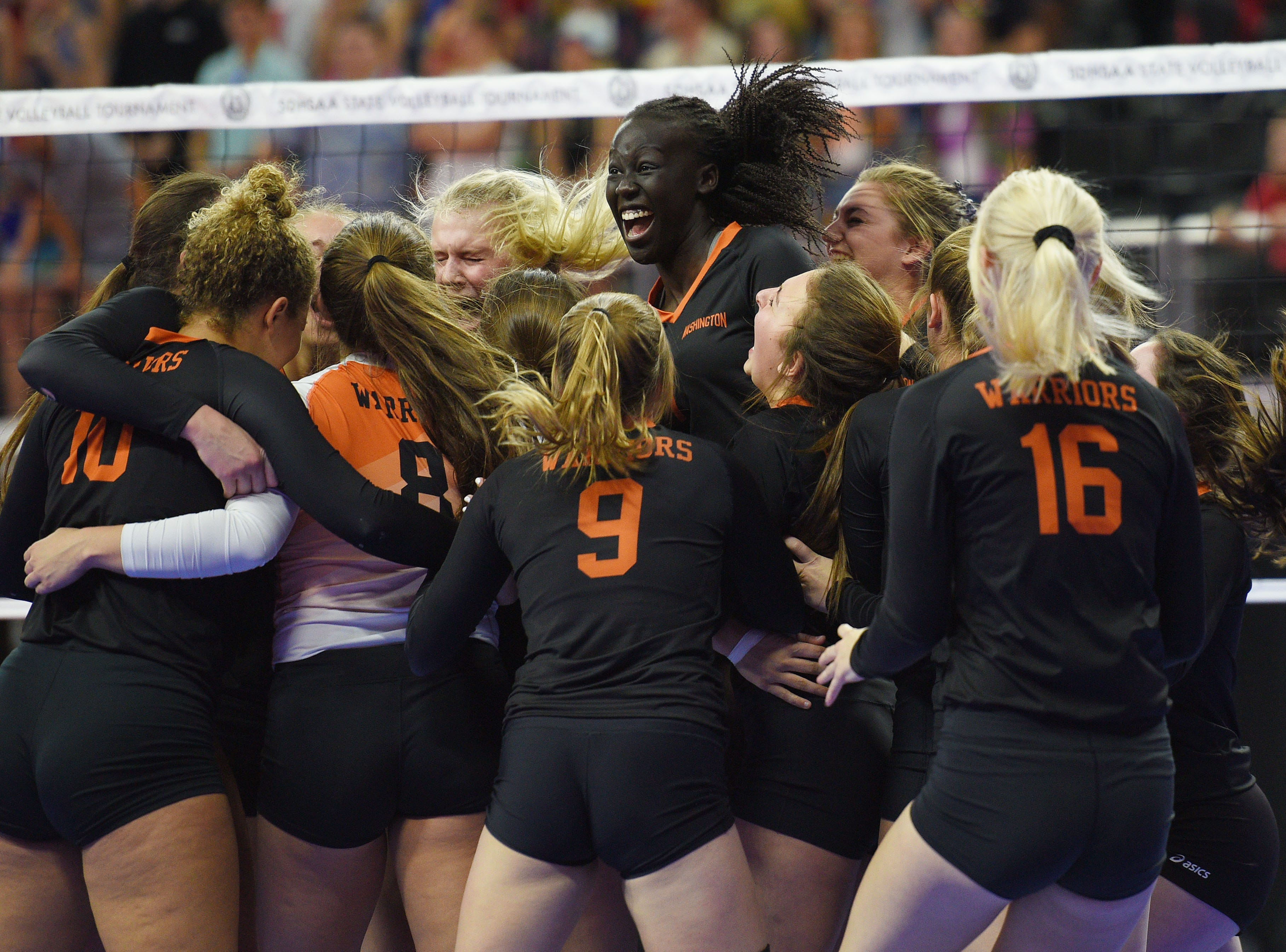 Washington celebrates after they win the game against O'Gorman during the semifinals Friday, Nov. 16, at the Denny Sanford Premier Center in Sioux Falls.