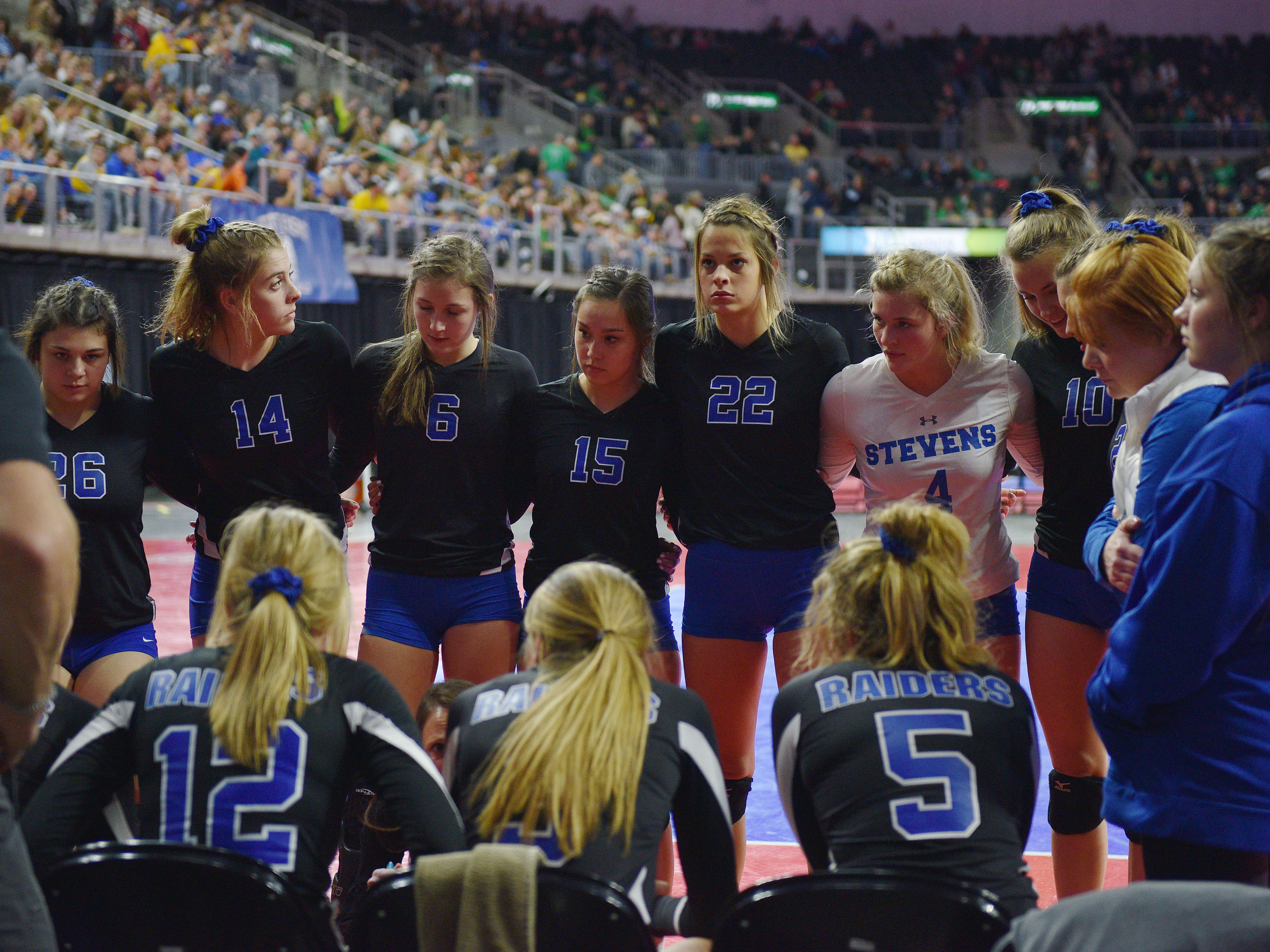 RC Stevens gets in a huddle in the game against Watertown during the semifinals Friday, Nov. 16, at the Denny Sanford Premier Center in Sioux Falls.