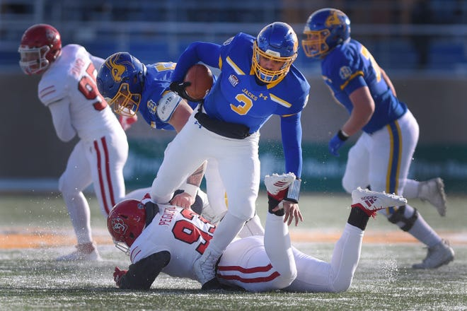 SDSU's Taryn Christion runs over USD's Luis Peguero during the game Saturday, Nov. 17, at Dana Dykhouse Stadium stadium in Brookings.