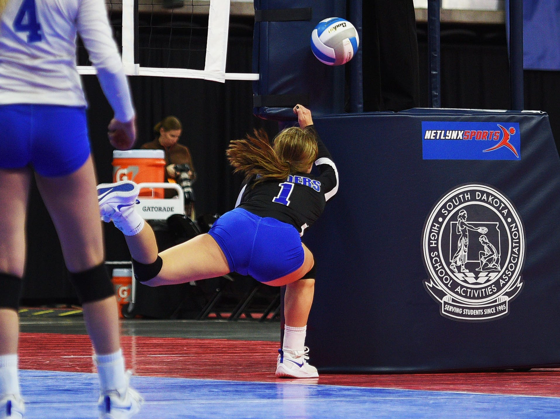 RC Stevens' Marlee Schneider dives into the post during the game against Watertown during the semifinals Friday, Nov. 16, at the Denny Sanford Premier Center in Sioux Falls.