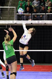Kylee Van Egdom of Sioux Falls Christian goes up to spike the ball past Morgan Erikson of McCook Central-Montrose during Friday's Class A semifinal in Sioux Falls.