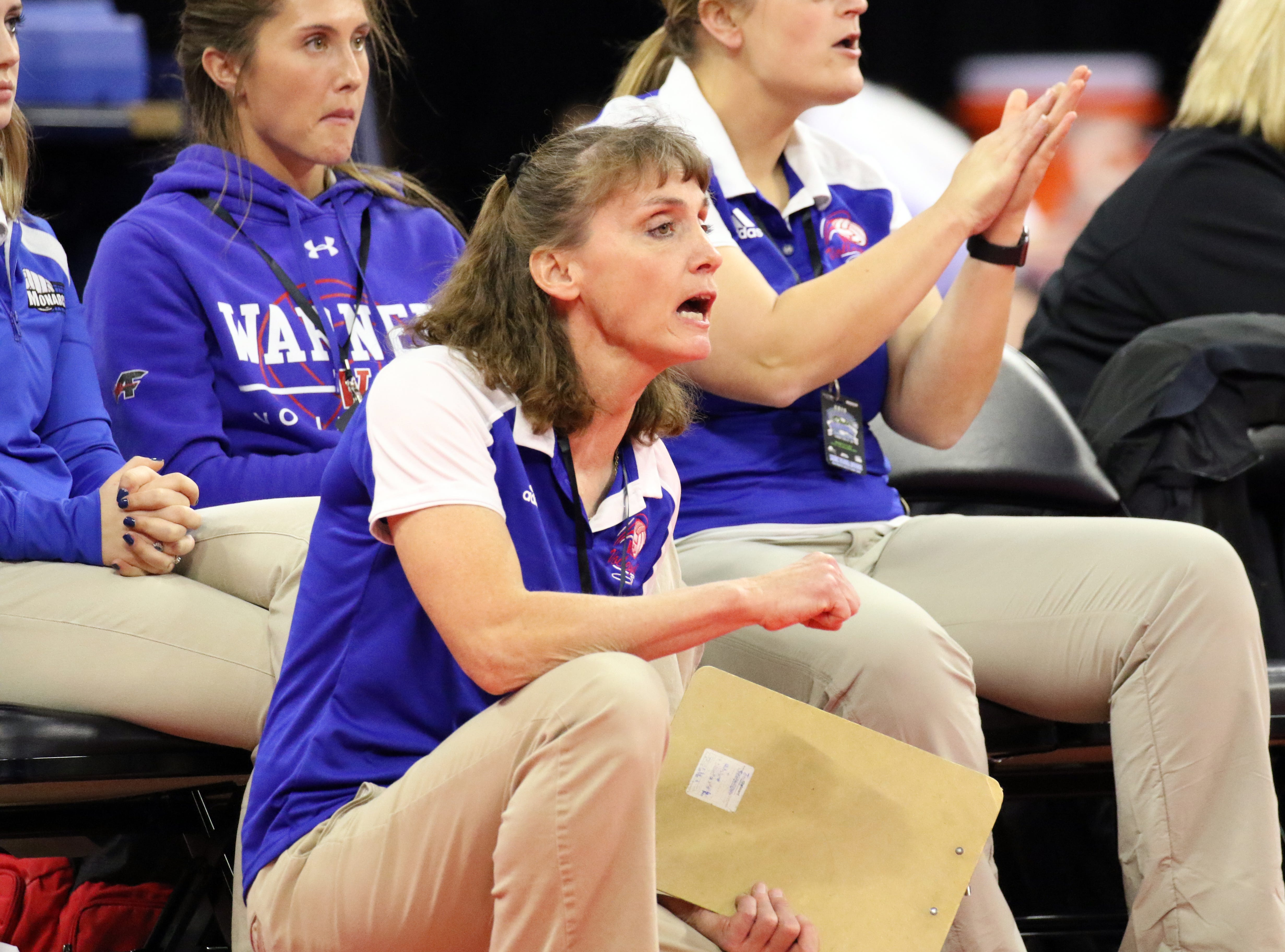 Warner head coach, Kari Jung shouts instructions during Friday's Class B semifinal match against Chester Area on Friday in Sioux Falls.