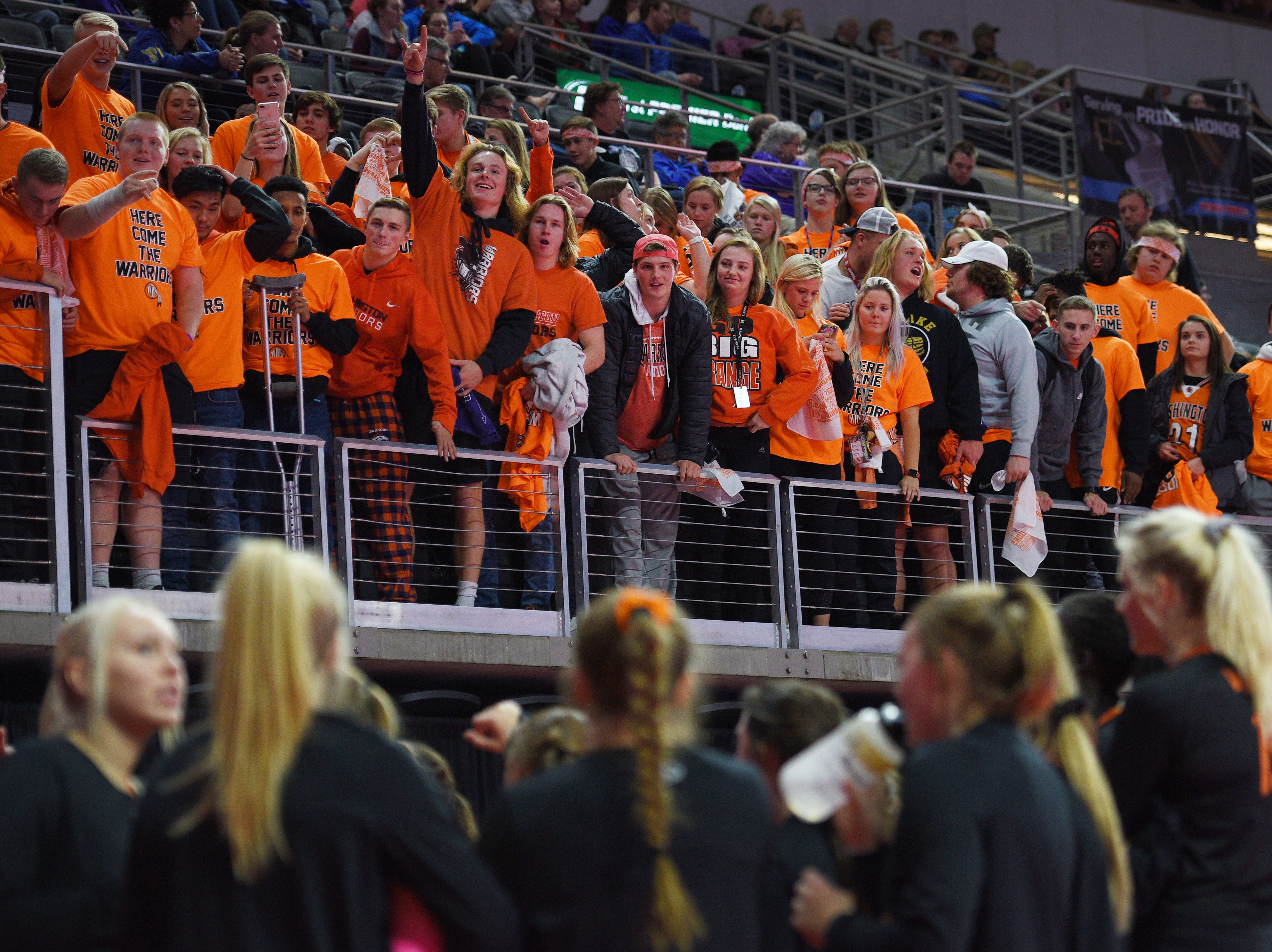 Washington's student section cheers at the players after their win against O'Gorman during the semifinals Friday, Nov. 16, at the Denny Sanford Premier Center in Sioux Falls.