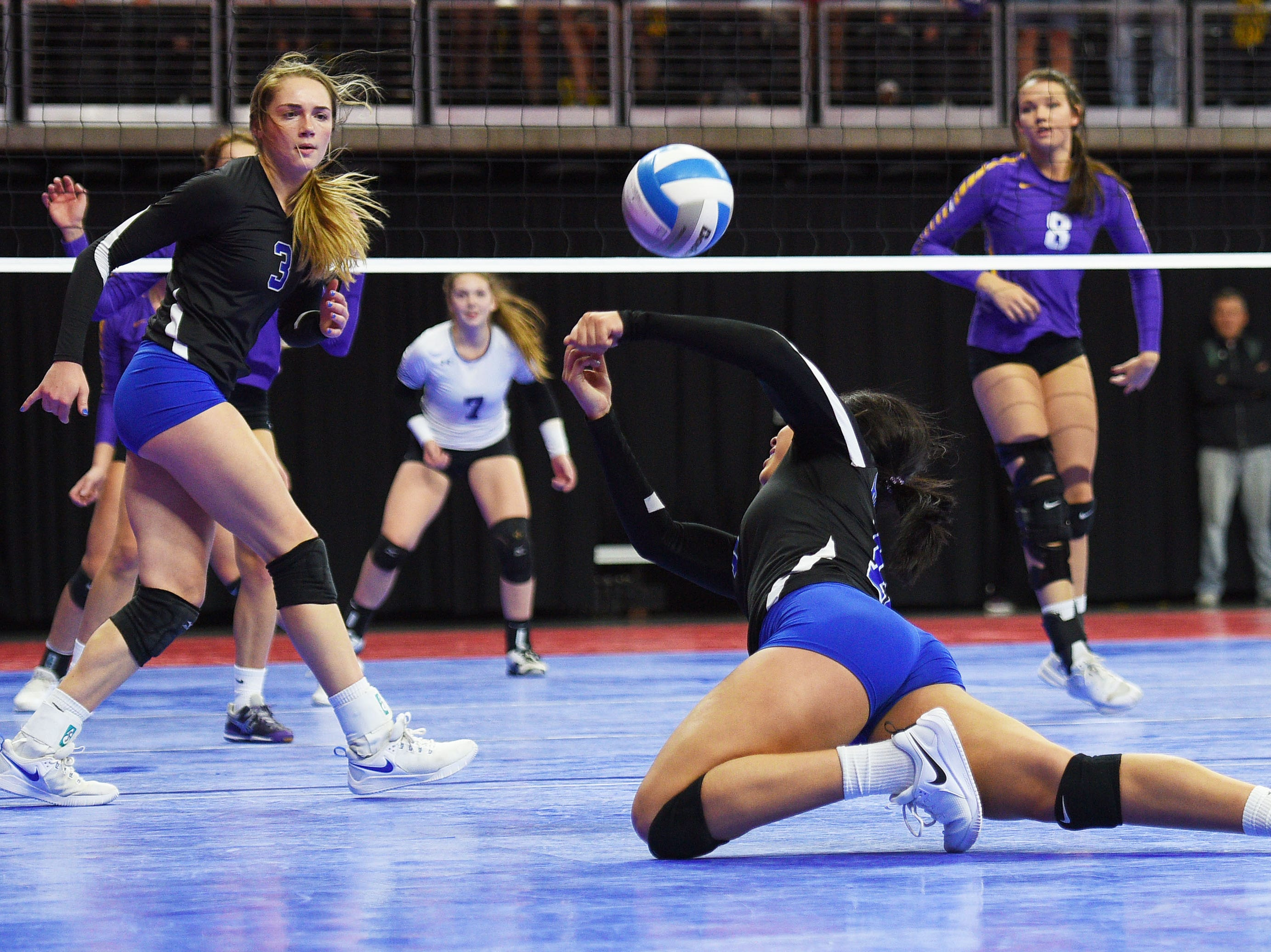 RC Stevens' Kyah Watson dives for the ball during the game against Watertown during the semifinals Friday, Nov. 16, at the Denny Sanford Premier Center in Sioux Falls.