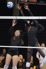 Washington's Phekran Kong (7) recorded 27 kills and 10 total blocks over three matches at the 2018 Class AA state tournament.