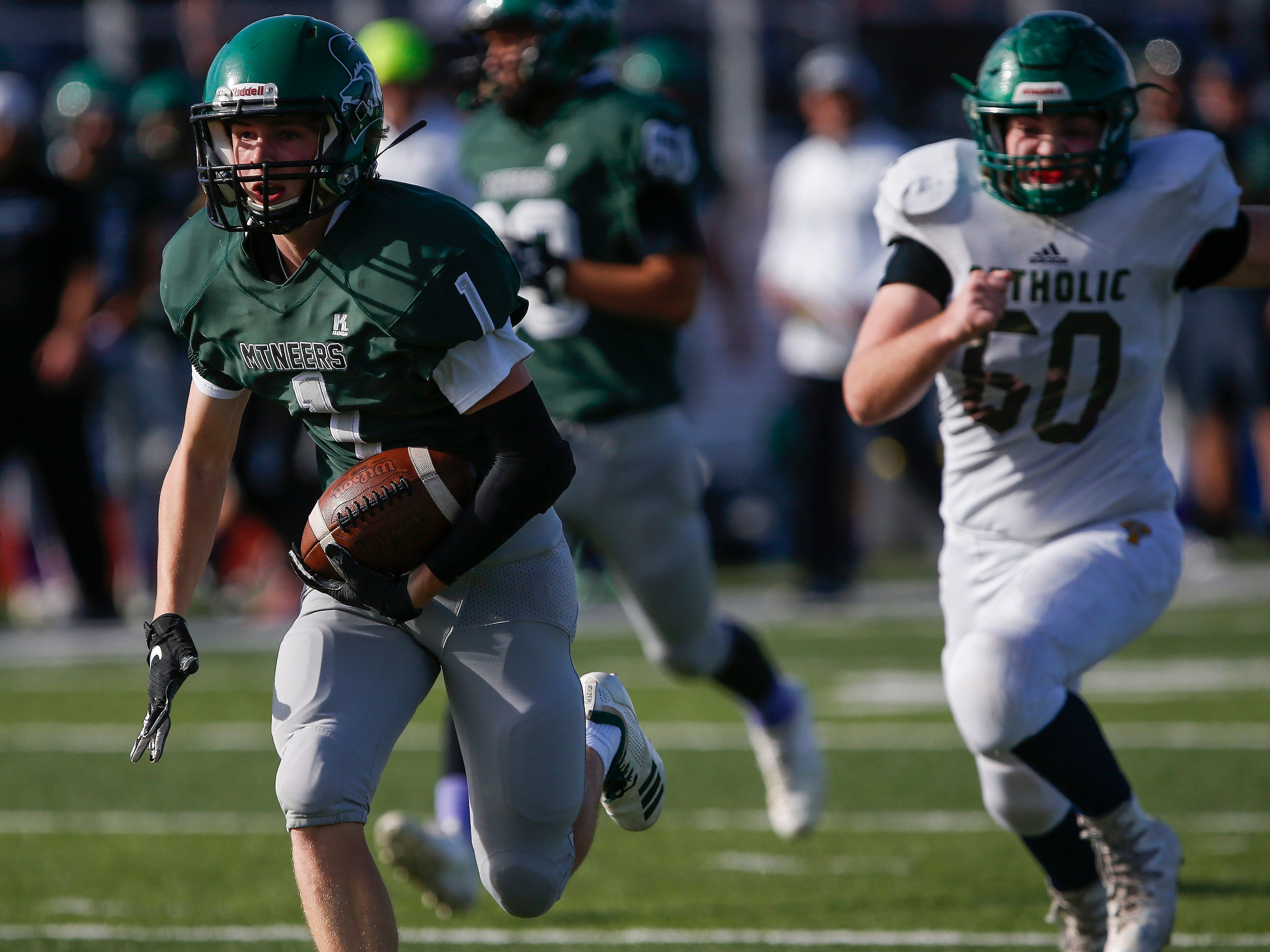 Kelly Vaughn, of Mount Vernon, runs the ball in for a touchdown in the Mountaineers 26-18 win in the Class 3 Quarterfinal game against Springfield Catholic at Mount Vernon High School on Saturday, Nov. 17, 2018.