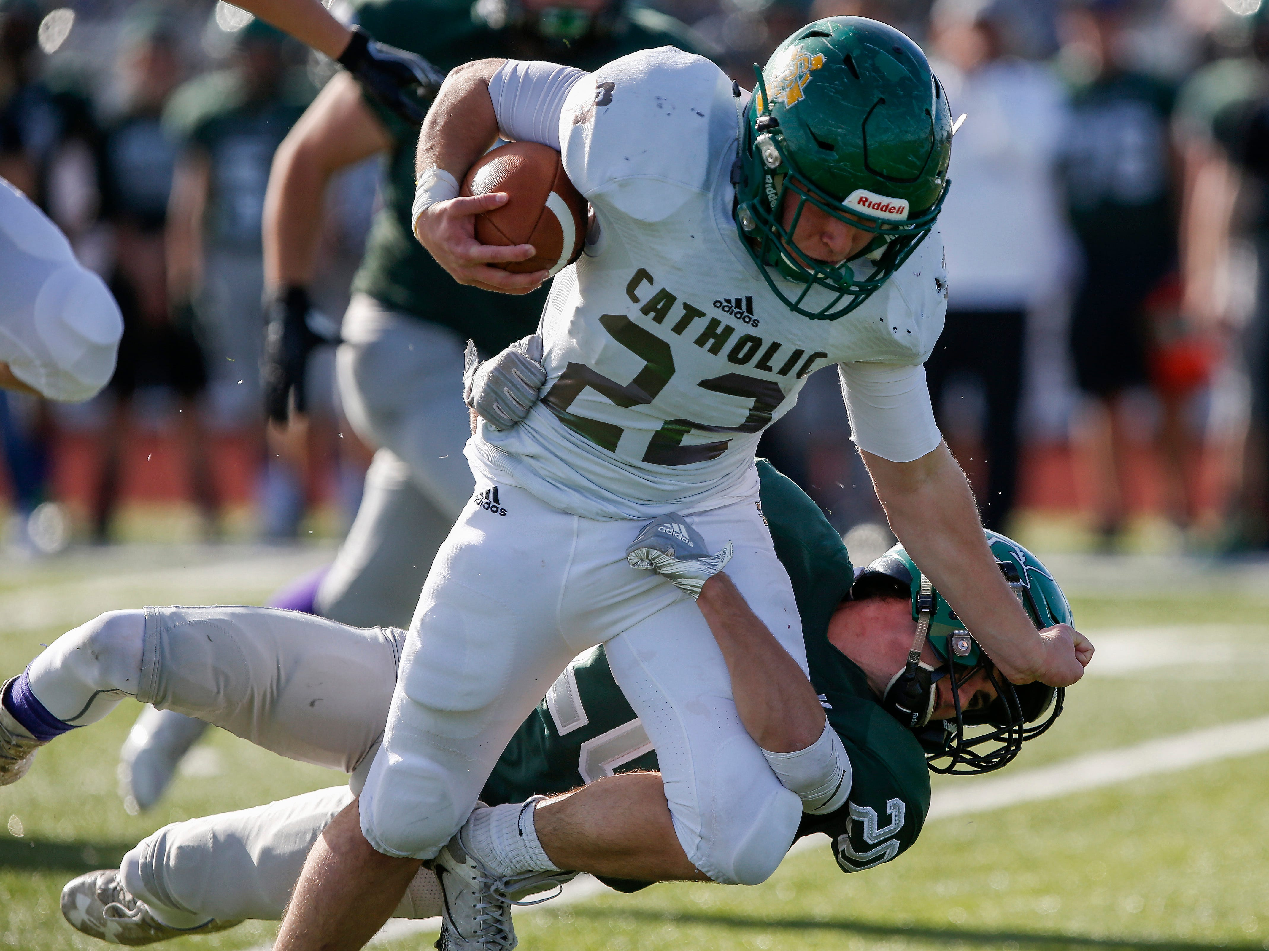 Nick Crites, of Springfield Catholic, stiff arms a Mount Vernon defender in the Irish's 26-18 loss in the Class 3 Quarterfinal game at Mount Vernon High School on Saturday, Nov. 17, 2018.