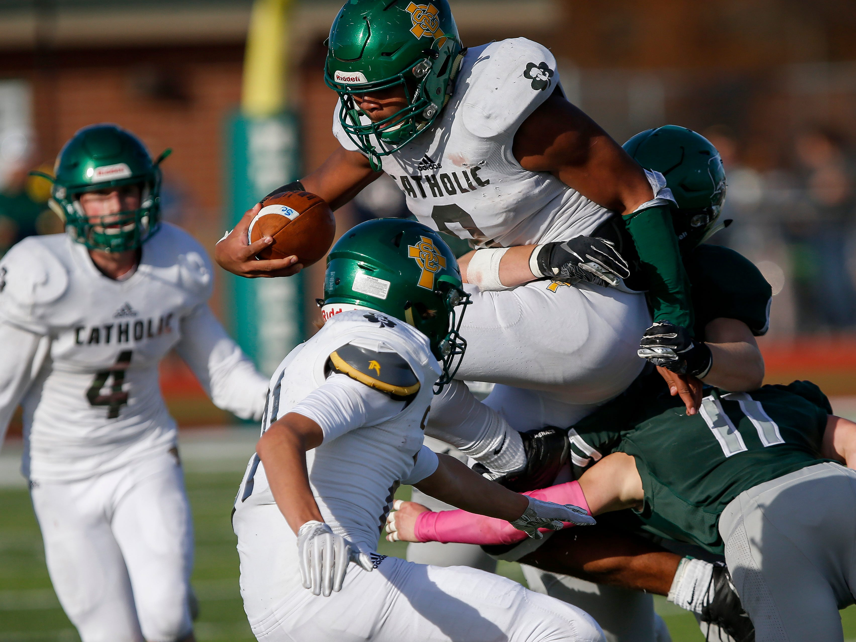 Tyson Riley, of Springfield Catholic, fights through Mount Vernon defenders in the Irish's 26-18 loss in the Class 3 Quarterfinal game at Mount Vernon High School on Saturday, Nov. 17, 2018.