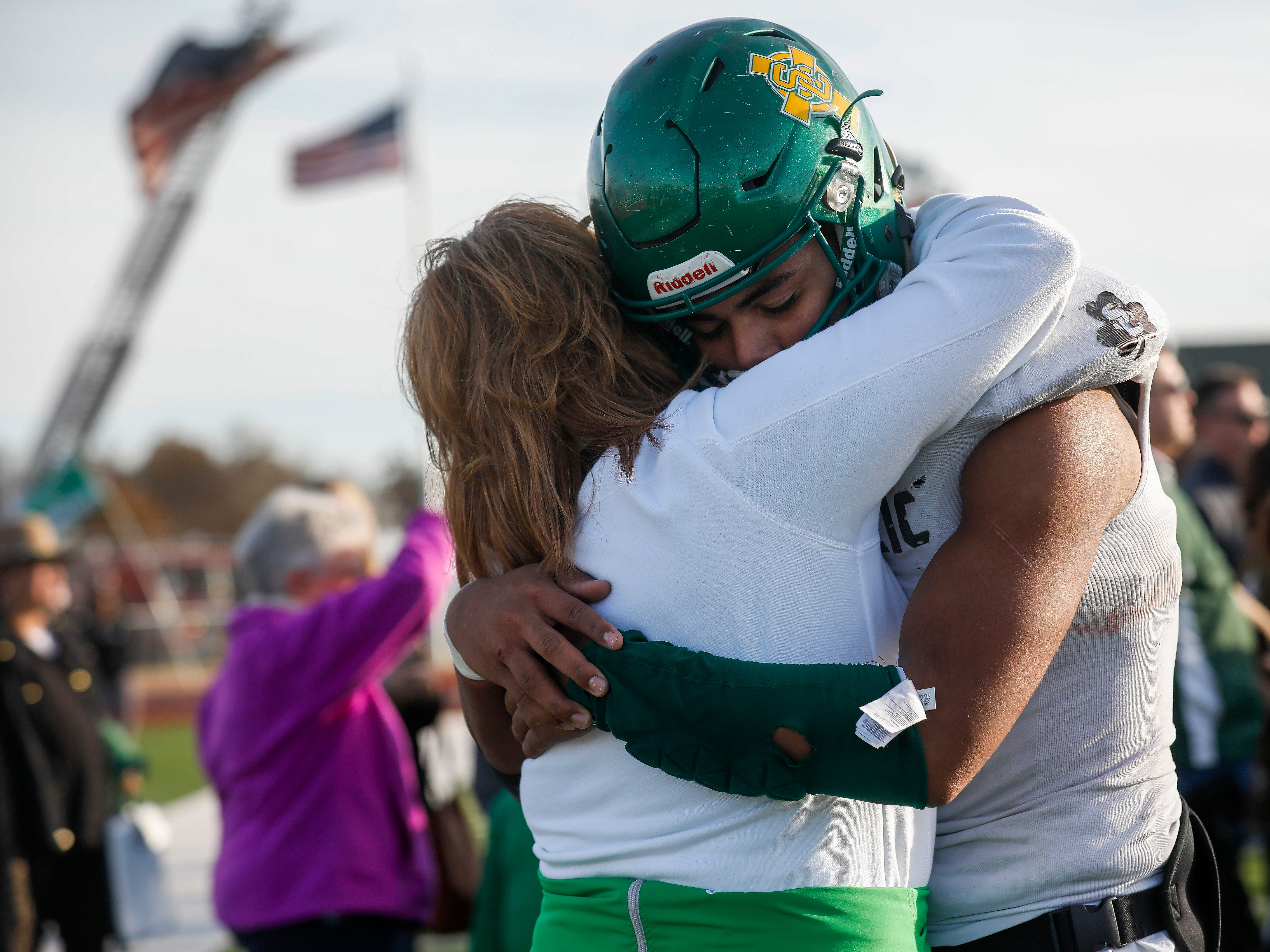 Tyson Riley, of Springfield Catholic, hugs his mom Nikki Riley after the Irish's 26-18 loss in the Class 3 Quarterfinal game against Mount Vernon at Mount Vernon High School on Saturday, Nov. 17, 2018.
