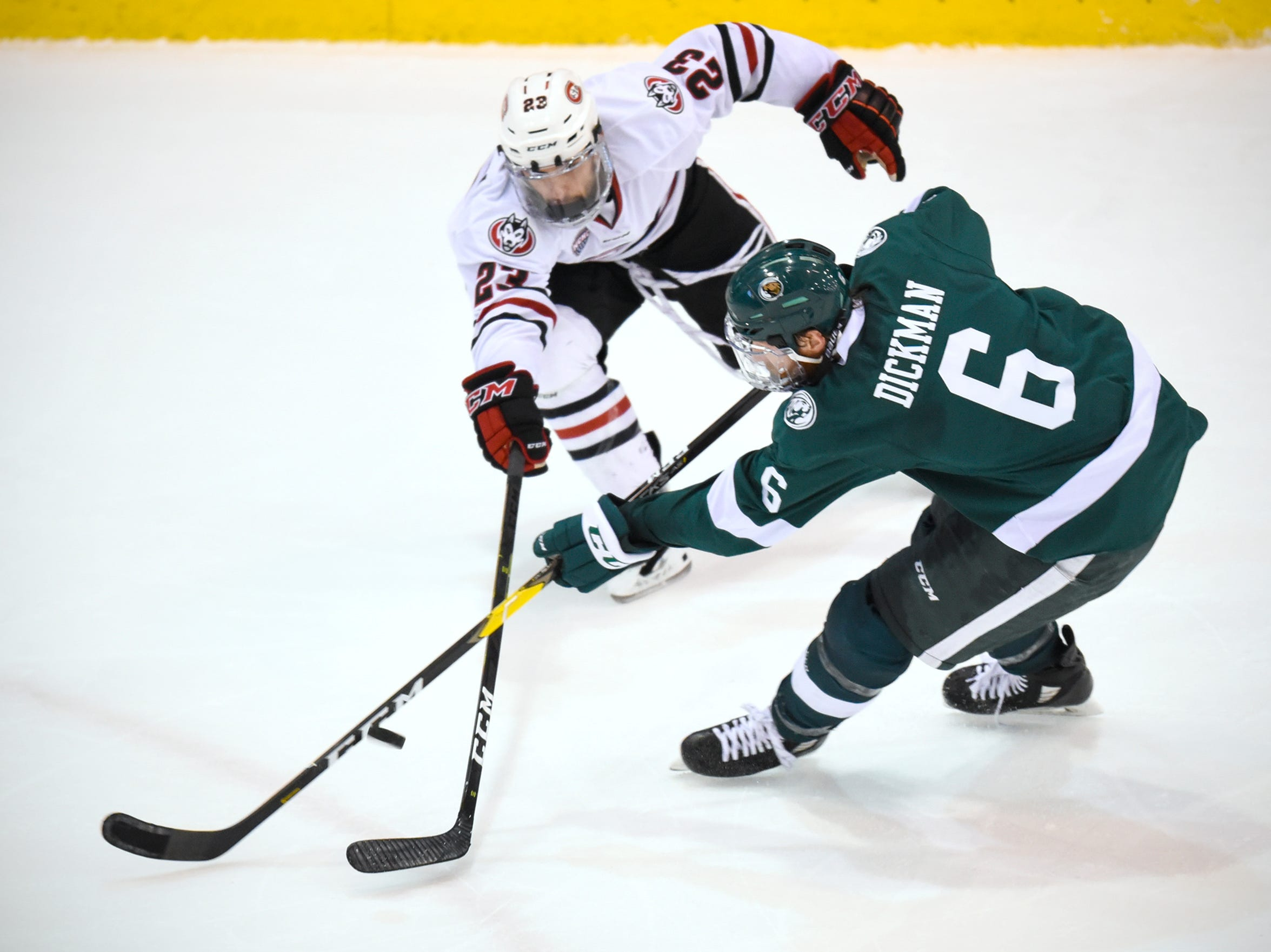 Robby Jackson of St. Cloud State and Jay Dickman of Bemidji State battle for control of the puck during the second period of the Friday, Nov. 16, game at the Herb Brooks National Hockey Center in St. Cloud.