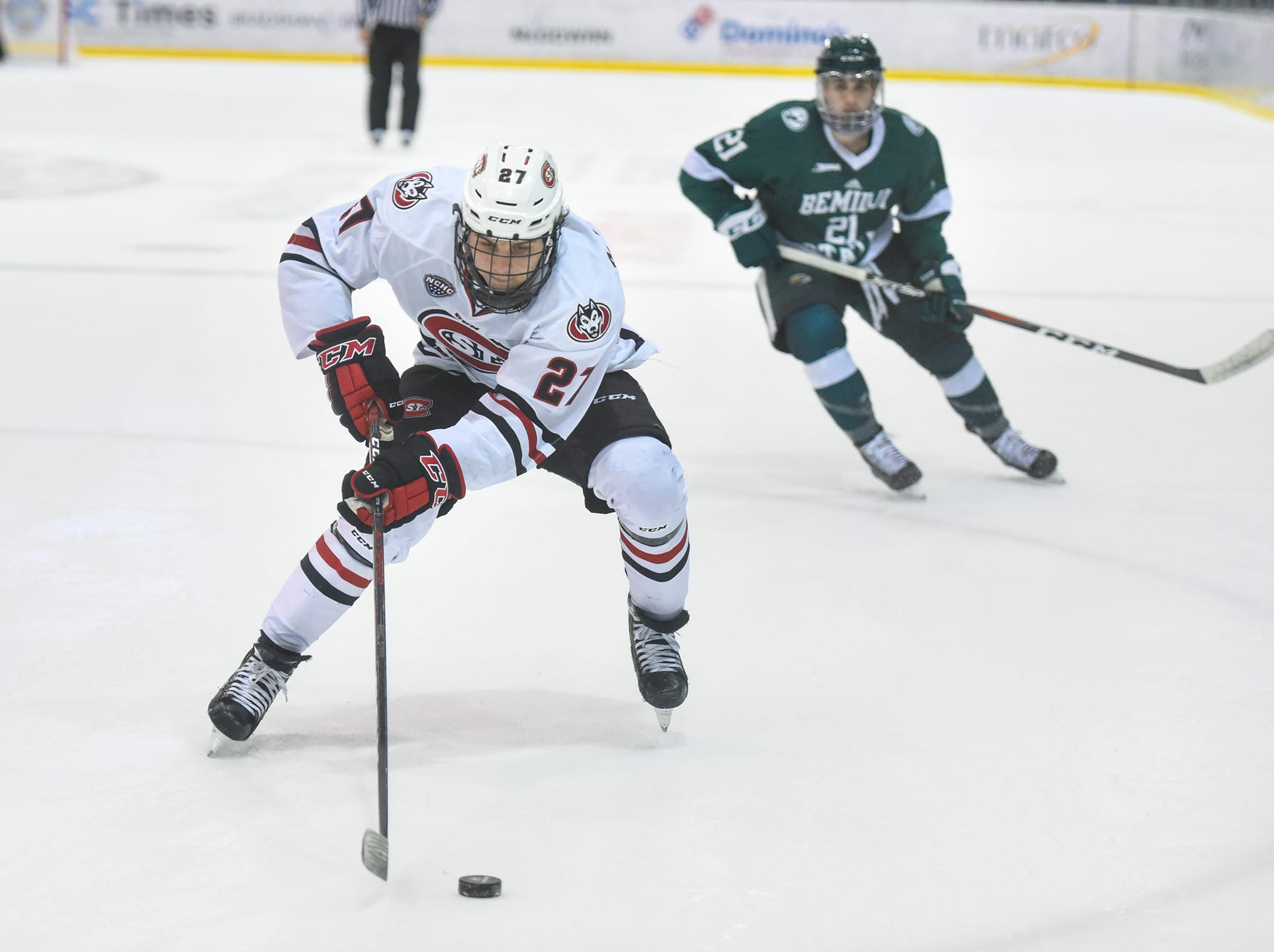 St. Cloud State's Blake Lizotte tries to control the puck in the Bemidji State zone during the first period of the Friday, Nov. 16, game at the Herb Brooks National Hockey Center in St. Cloud.