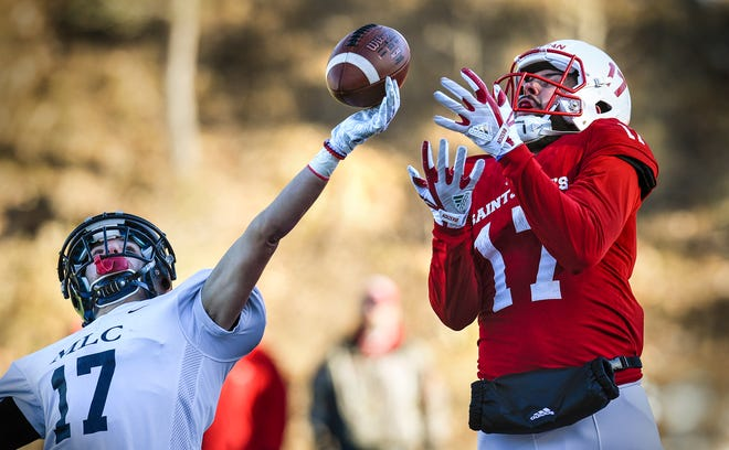 Jared Witkowiak of Martin Luther College tries to break up a pass play to Tyler Hartigan of St. John's during the first half of the Saturday, Nov. 17, game at Clemens Stadium in Collegeville.