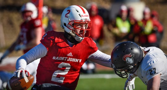 Jackson Erdmann looks for an open receiver during the first half of the Saturday, Nov. 17, game against Martin Luther College at Clemens Stadium in Collegeville.