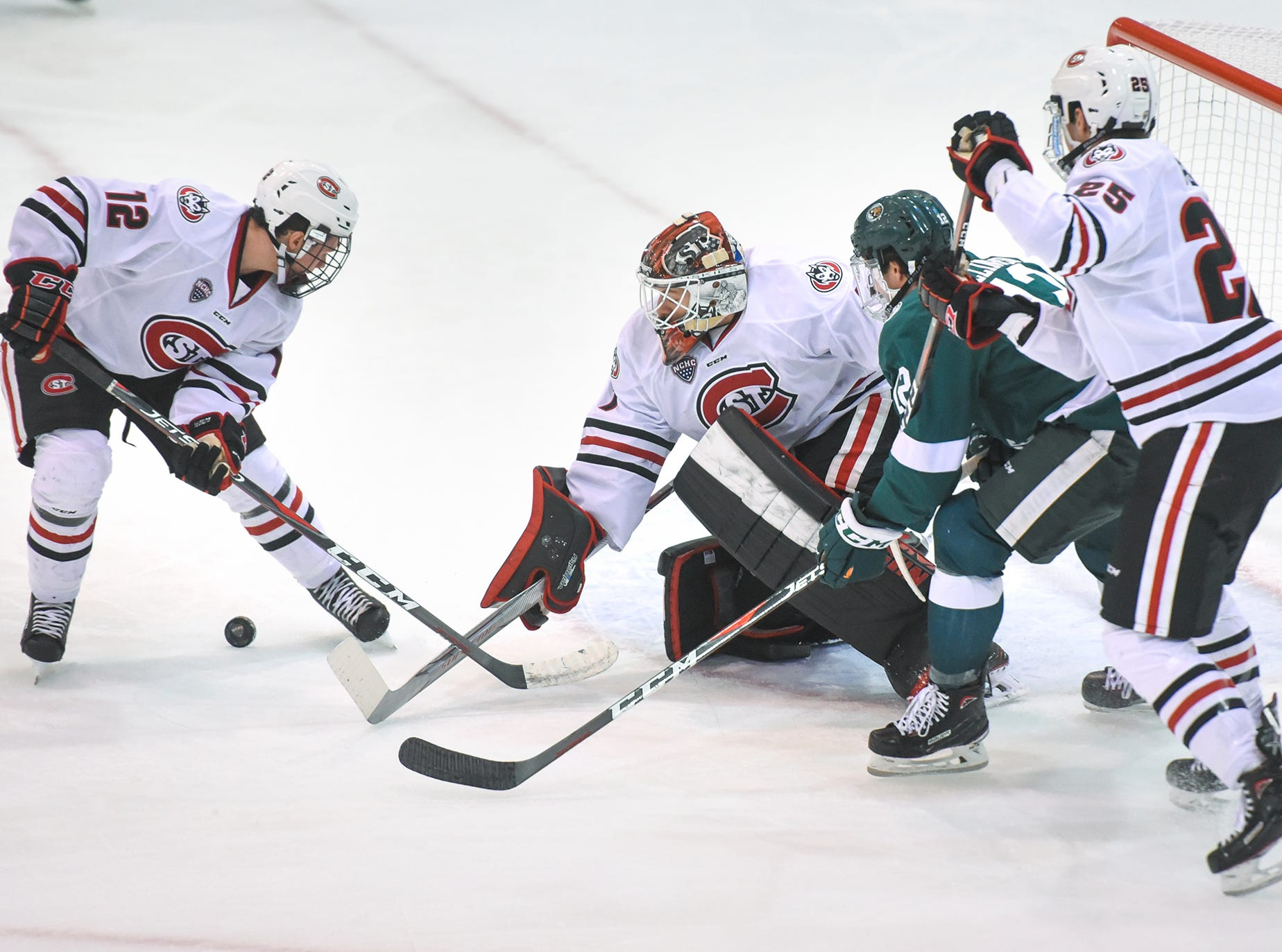 The puck bounces in front of the St. Cloud State goal during the first period of the Friday, Nov. 16, game against Bemidji State at the Herb Brooks National Hockey Center in St. Cloud.