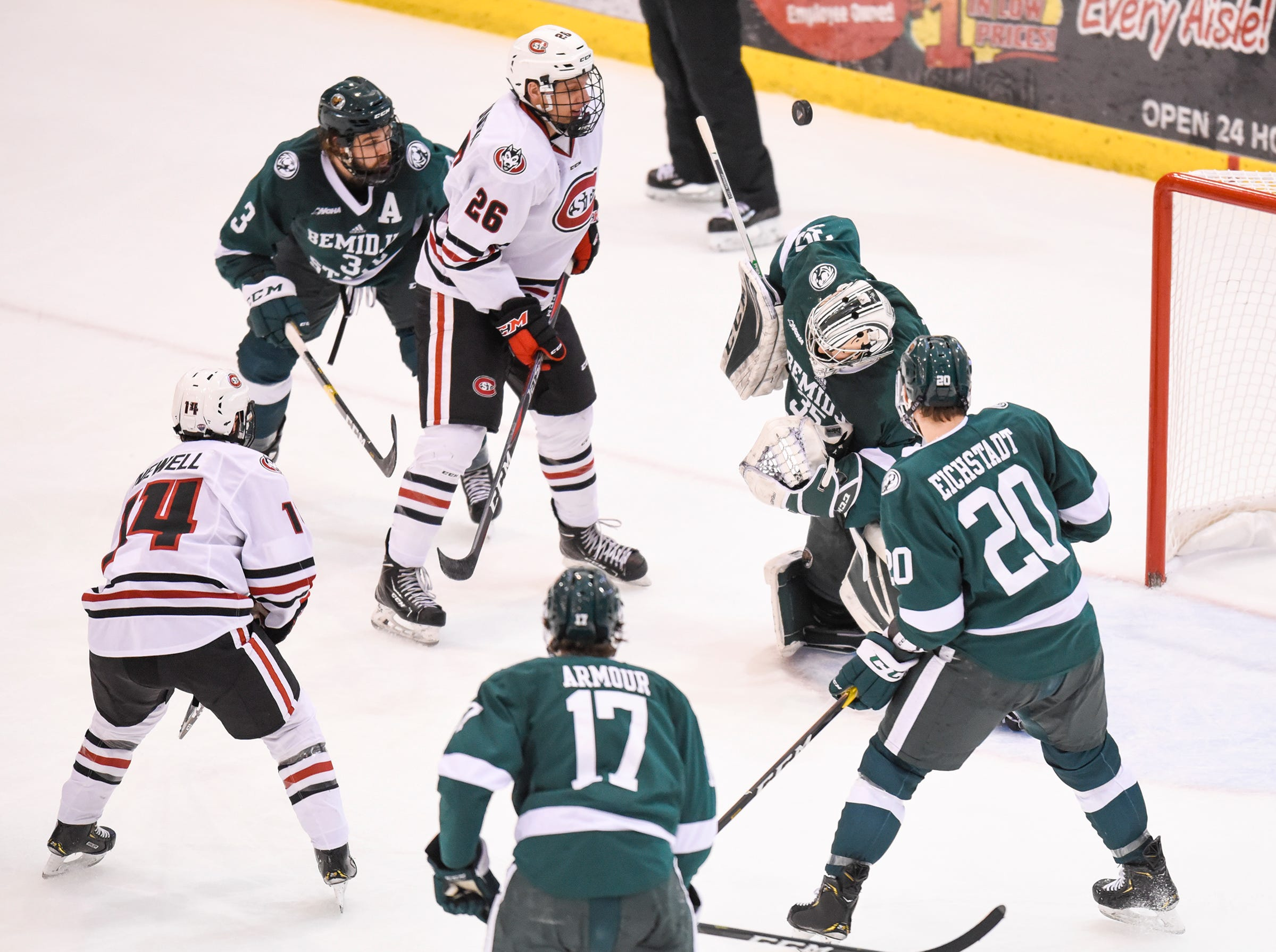 The puck bounces high over Bemidji State goaltender Henry Johnson during the second period of the Friday, Nov. 16, game at the Herb Brooks National Hockey Center in St. Cloud.