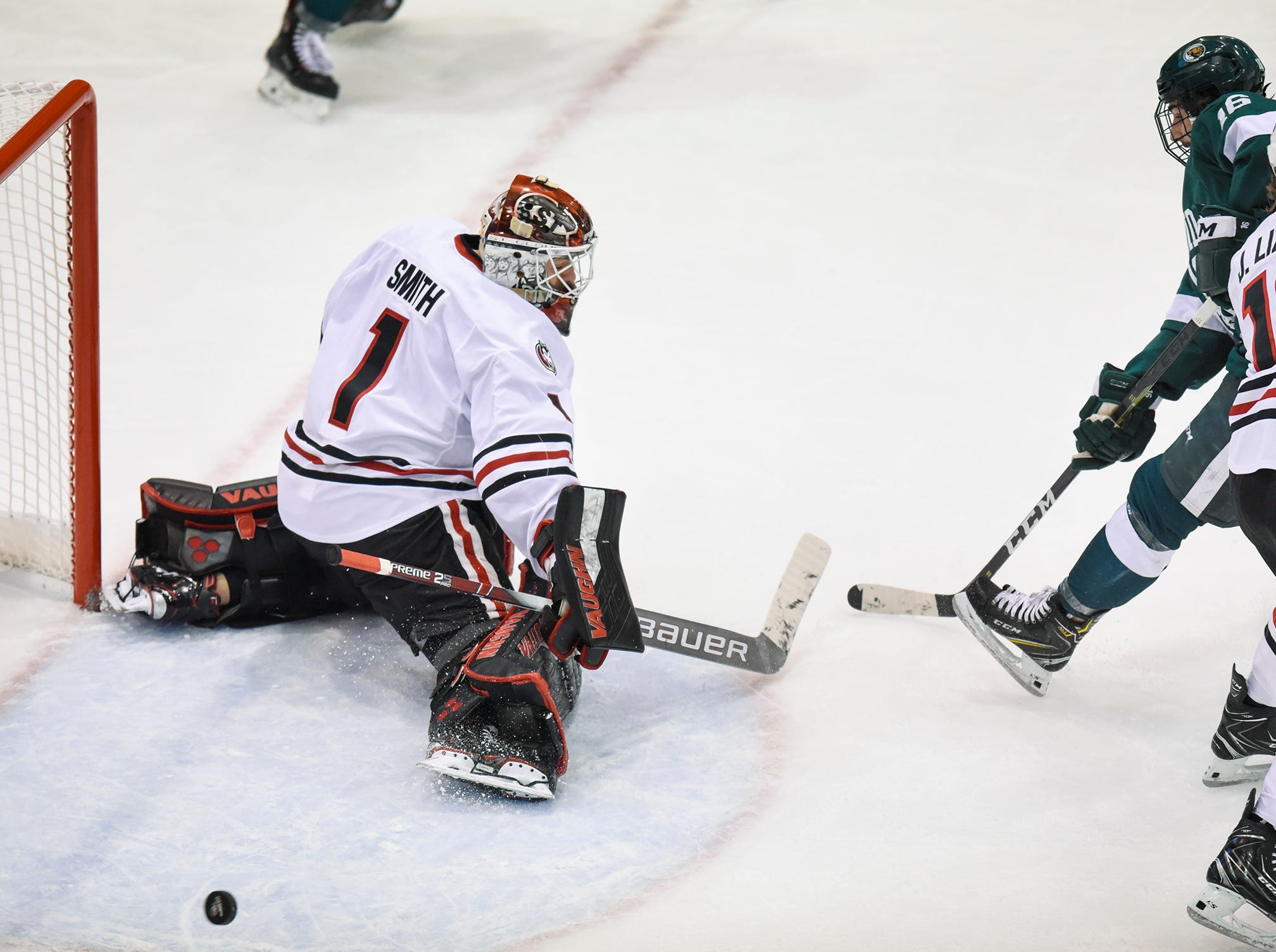 St. Cloud State goaltender Jeff Smith makes a save during the second period of the Friday, Nov. 16, game against Bemidji State at the Herb Brooks National Hockey Center in St. Cloud.