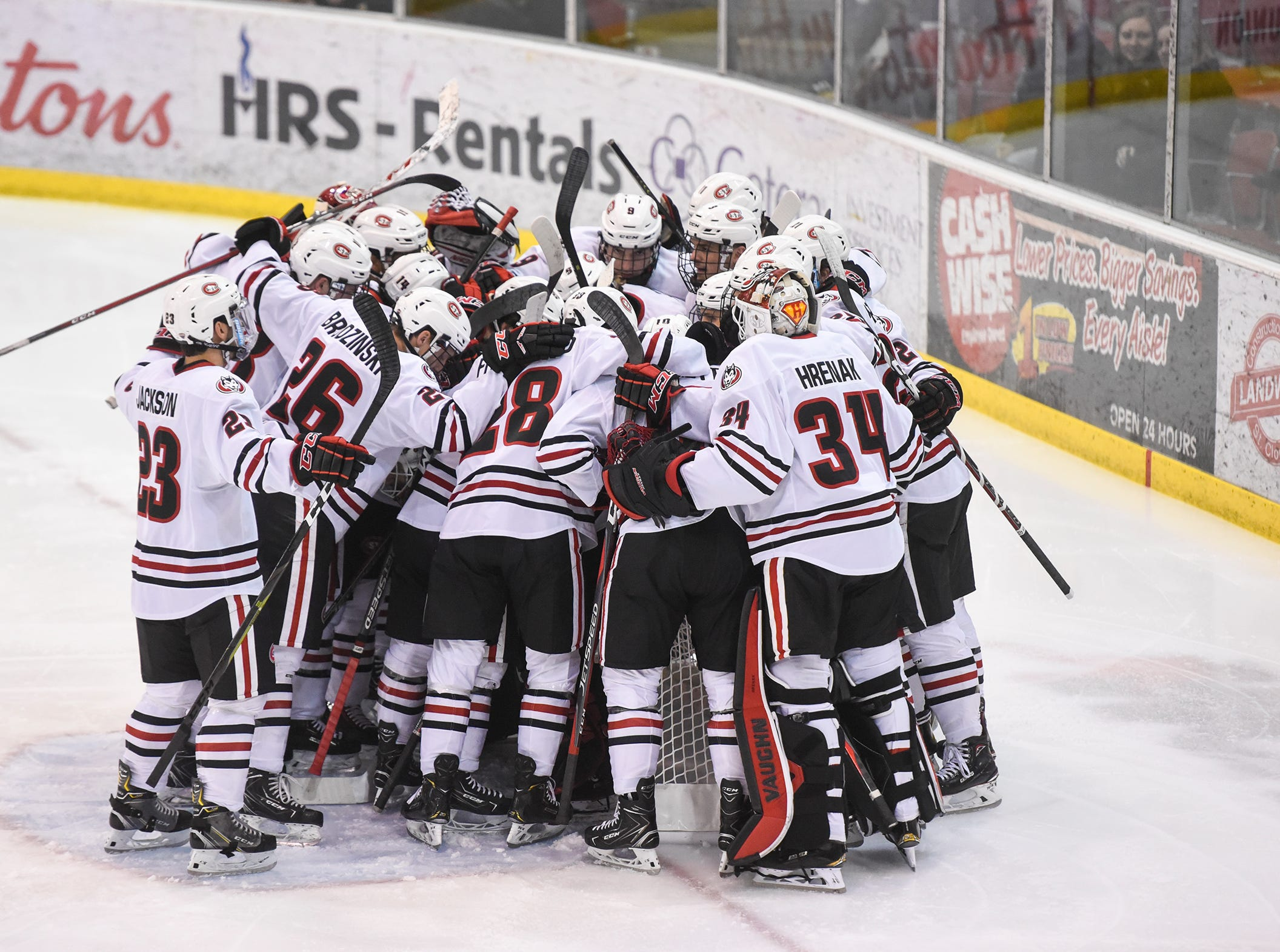 St. Cloud State players gather around their goal before the start of the Friday, Nov. 16, game against Bemidji State at the Herb Brooks National Hockey Center in St. Cloud.