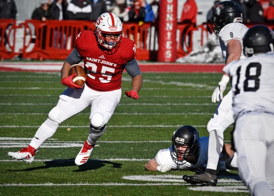Kai Barber carries the ball for St. John's during the first half of the Saturday, Nov. 17, game against Martin Luther College at Clemens Stadium in Collegeville.
