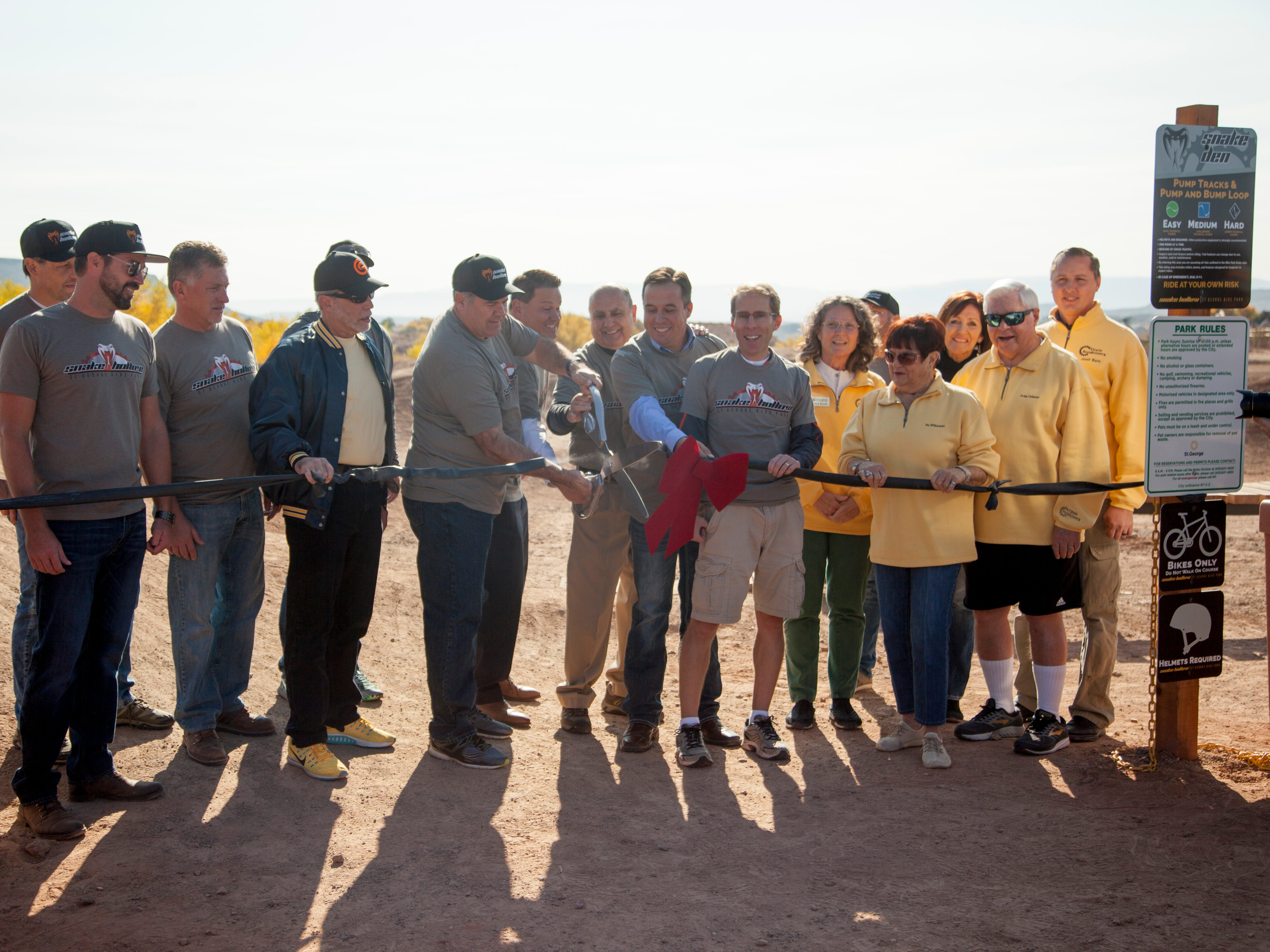 St. George Mayor Jon Pike cuts the ceremonial ribbon, officially opening Snake Hollow Bike Park on Nov. 17, 2018.