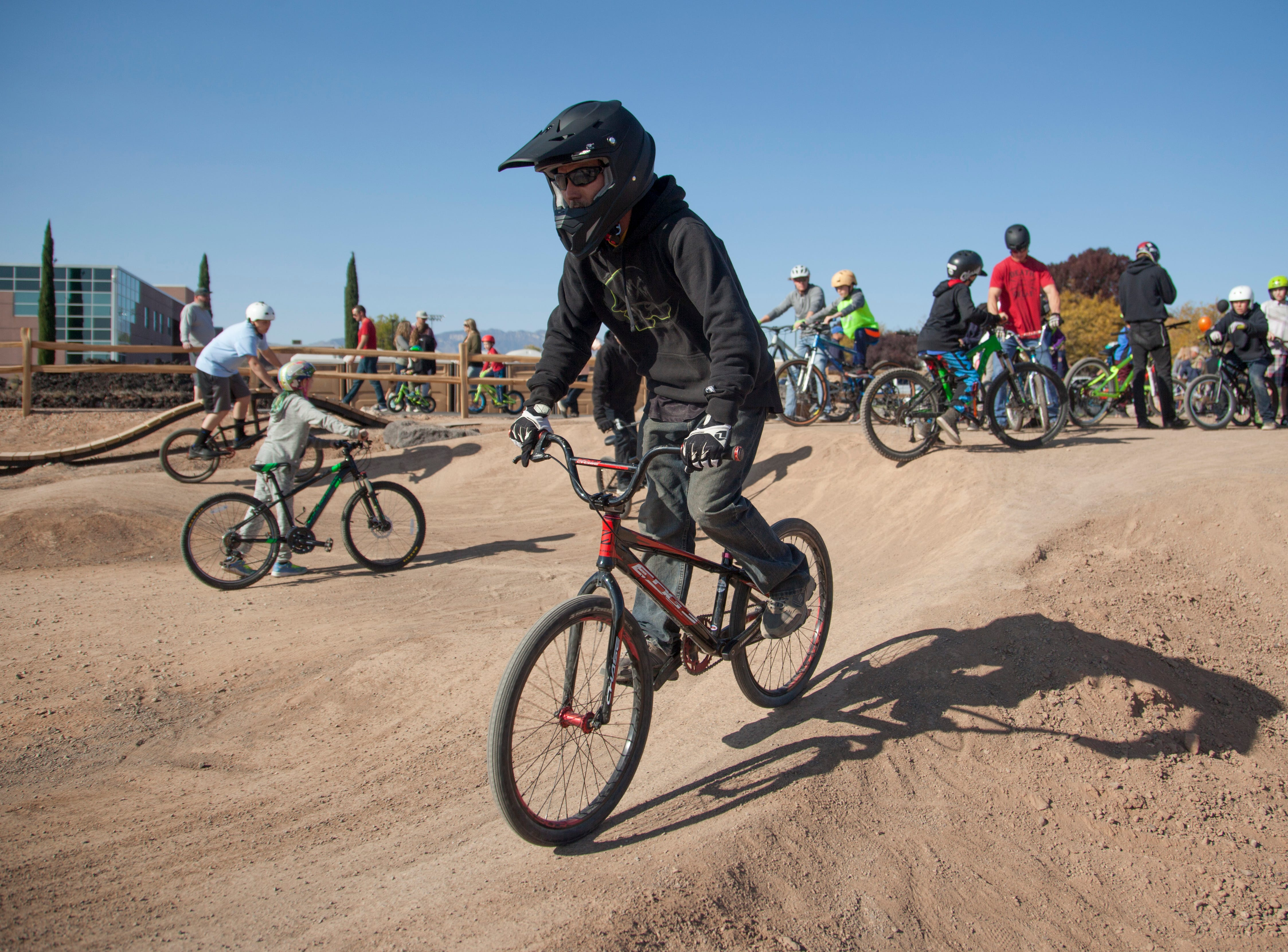 Cyclists from around the St. George area gather for the opening of Snake Hollow Saturday, Nov. 17, 2018. The new bike park is designed to help cyclists develop skills in a safe environment.
