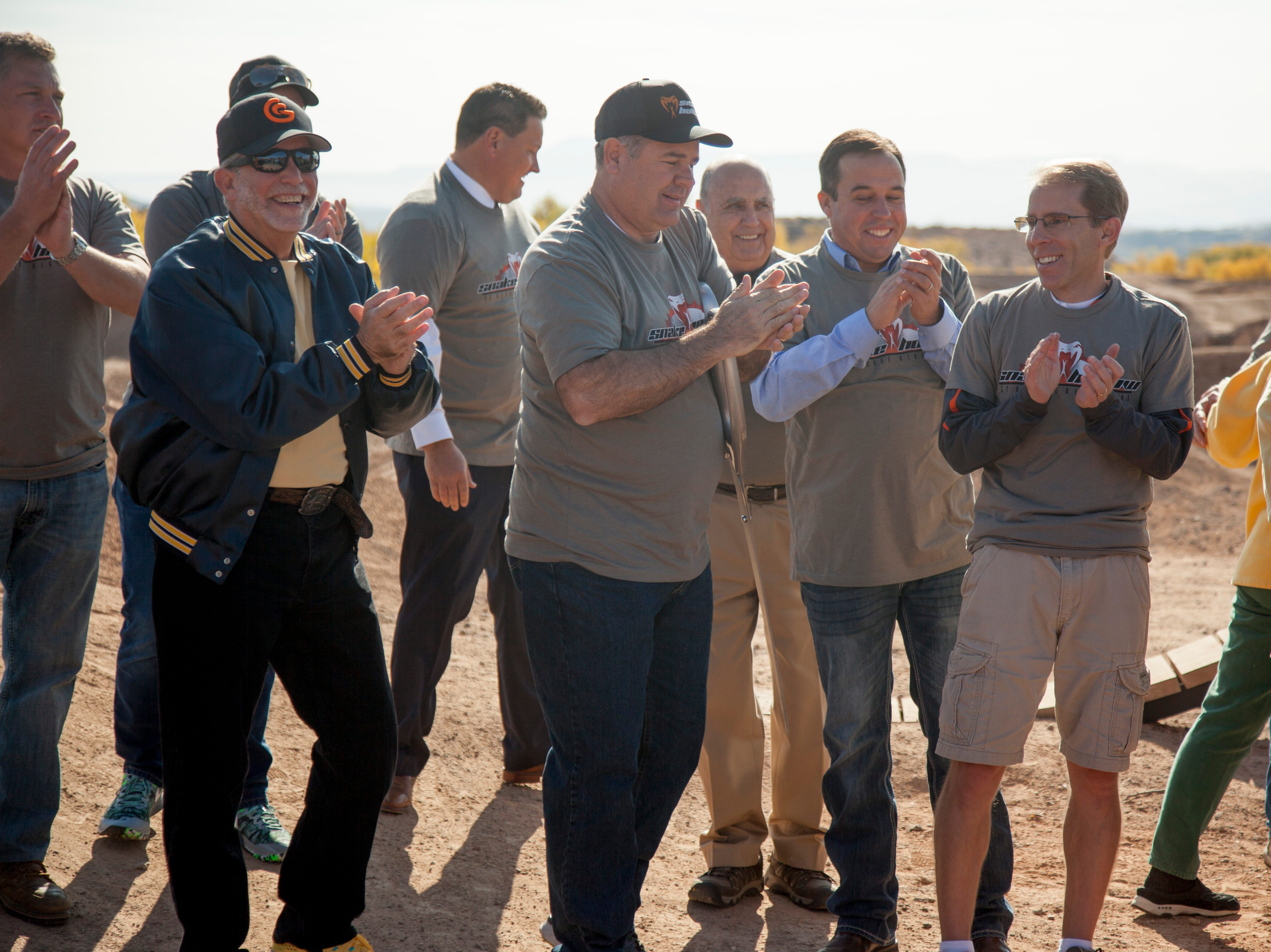 Key players in the project, including officials from Washington County and St. George, applaud after the ribbon cutting at Snake Hollow on Saturday, Nov. 17, 2018.