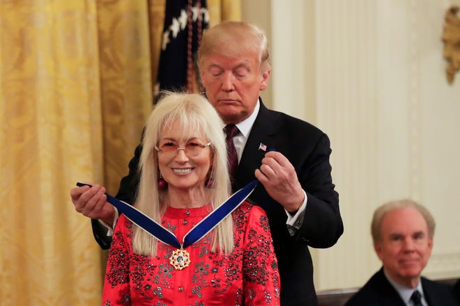 President Donald Trump presents the Presidential Medal of Freedom to Miriam Adelson during a ceremony in the East Room of the White House, in Washington, Friday, Nov. 16, 2018.