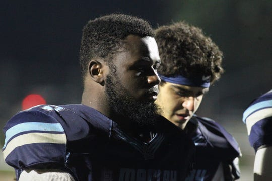 Maclay senior Eljin Rhymes listens to his coach talk after Maclay fell 47-21 to University Christian during a Region 1-2A semifinal on Friday, Nov. 16, 2018.