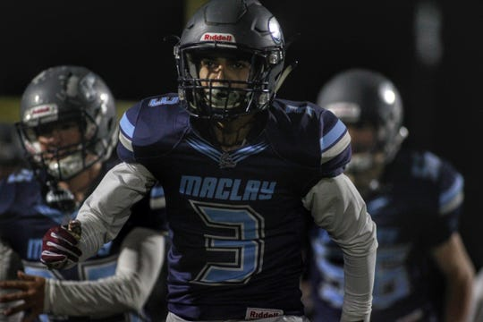 Maclay senior Austin Ghazvini runs onto the field before a game, as Maclay fell 47-21 to University Christian during a Region 1-2A semifinal on Friday, Nov. 16, 2018.