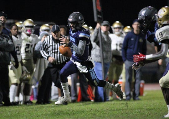Maclay quarterback Brecht Heuchan runs for a first down on 4th and 16 as Maclay fell 47-21 to University Christian during a Region 1-2A semifinal on Friday, Nov. 16, 2018.