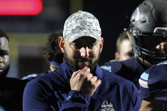 A smile forms on the face of an emotional Maclay football coach Lance Ramer as he listens to his players talk about what the season meant to them. Maclay fell 47-21 to University Christian during a Region 1-2A semifinal on Friday, Nov. 16, 2018, ending a 10-1 year.