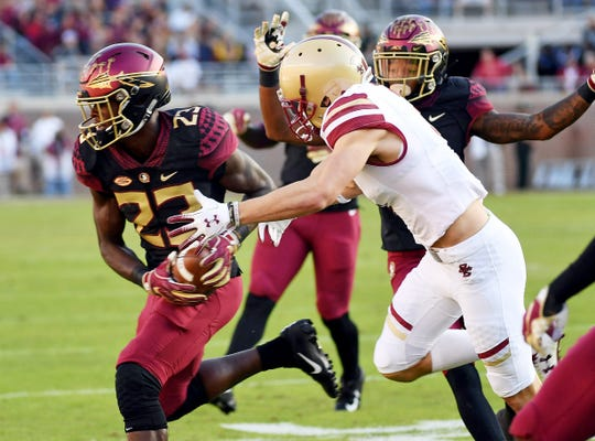 Nov 17, 2018; Tallahassee, FL, USA; Florida State Seminoles safety Hamsah Nasirildeen (23) intercepts a pass during the first half against the Boston College Eagles at Doak Campbell Stadium. Mandatory Credit: Melina Myers-USA TODAY Sports