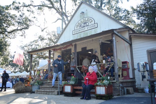 Visitors enjoy time at Bradley's Country Store Saturday for the 48th Annual Old Fashioned Fun Day. Attendees could shop craft booths, watch dancers or grab a smoked Bradley's sausage.