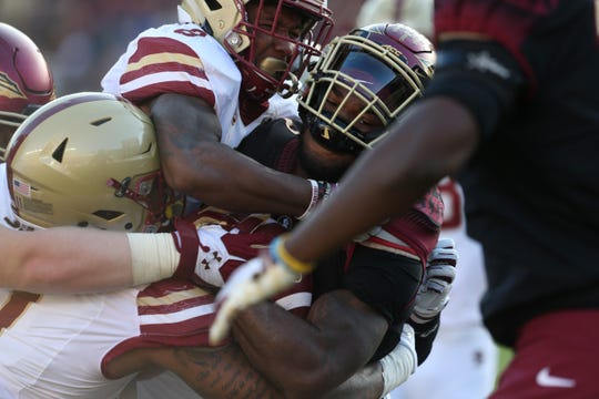 Florida State Seminoles running back Cam Akers (3) goes down from the Boston College Eagle defnese as the Florida State Seminoles face off against the Boston College Eagles at Doak S. Campbell Stadium, Saturday, Nov. 17, 2018.
