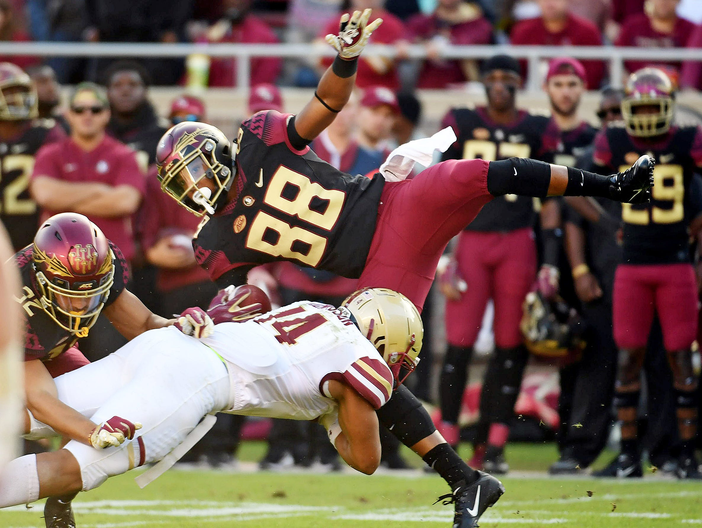 Nov 17, 2018; Tallahassee, FL, USA; Florida State Seminoles wide receiver Tre'Shaun Harrison (88) is tackled by Boston College Eagles linebacker Max Richardson (14) during the first half at Doak Campbell Stadium. Mandatory Credit: Melina Myers-USA TODAY Sports