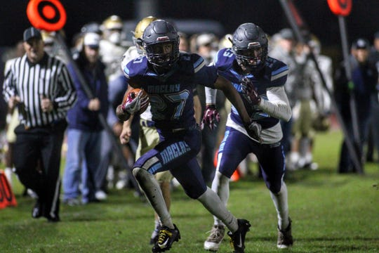 Maclay's Robert Parker-Crawford takes off on a reverse as Maclay fell 47-21 to University Christian during a Region 1-2A semifinal on Friday, Nov. 16, 2018.