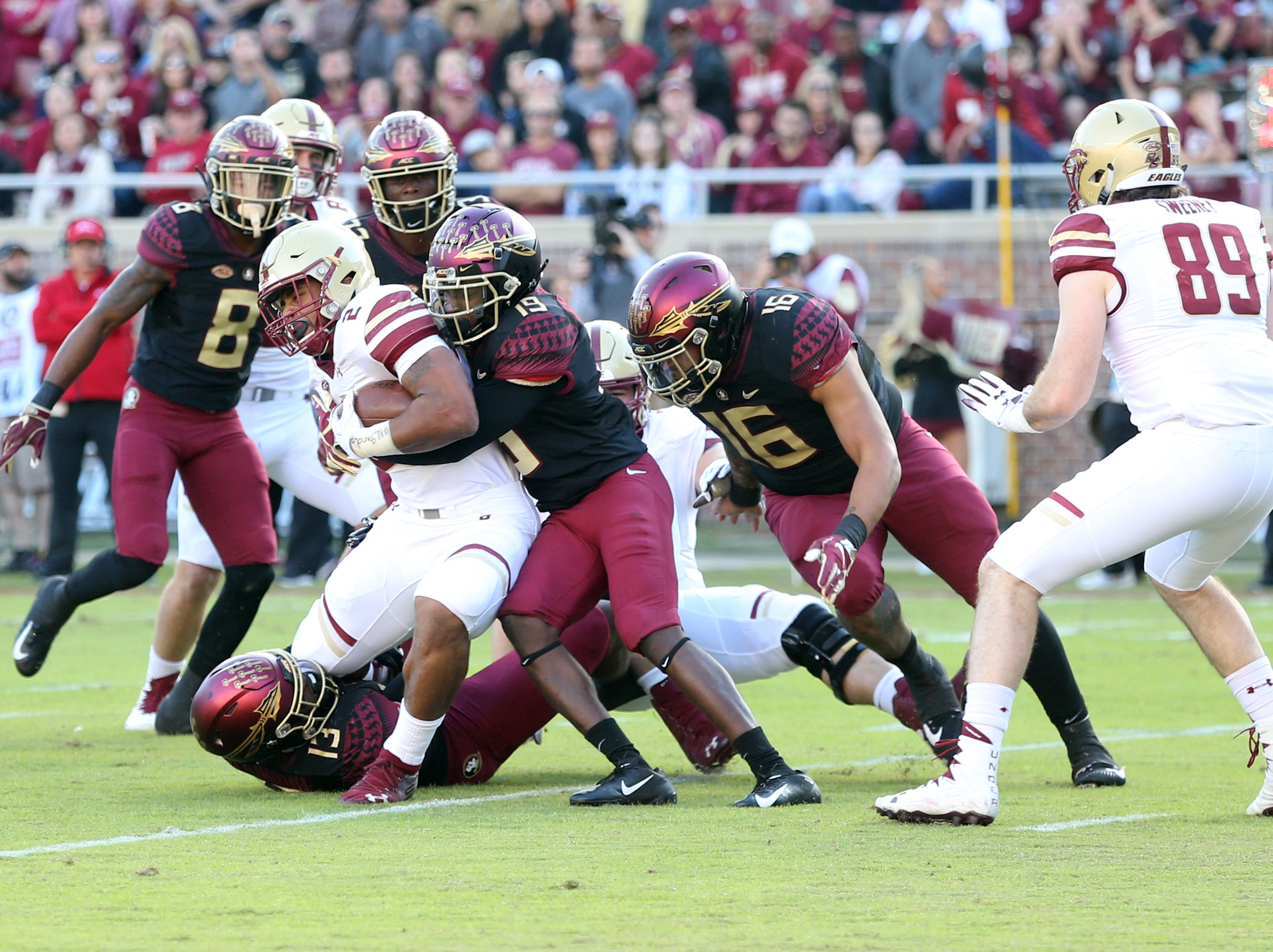 Florida State Seminoles defensive back A.J. Westbrook (19) tackles Boston College Eagles running back AJ Dillon (2 as )the Florida State Seminoles face off against the Boston College Eagles at Doak S. Campbell Stadium, Saturday, Nov. 17, 2018.
