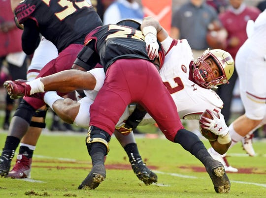 Nov 17, 2018; Tallahassee, FL, USA; Florida State Seminoles linebacker DeCalon Brooks (28) tackles Boston College Eagles running back AJ Dillon (2) during the first half at Doak Campbell Stadium. Mandatory Credit: Melina Myers-USA TODAY Sports