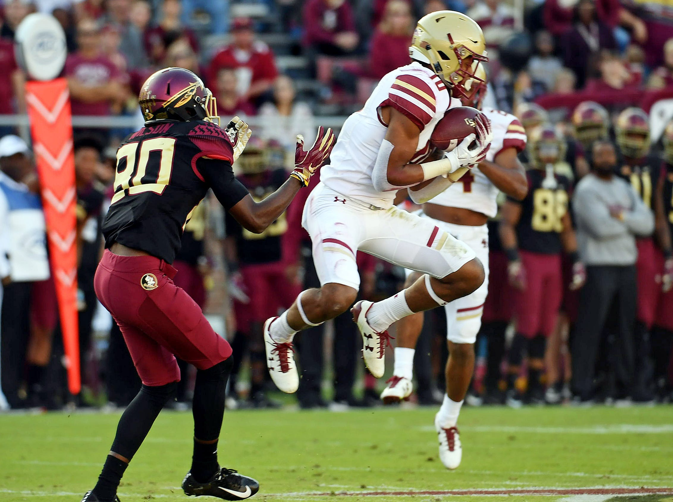 Nov 17, 2018; Tallahassee, FL, USA; Boston College Eagles defensive back Brandon Sebastian (10) intercepts a pass intended for Florida State Seminoles wide receiver Keyshawn Helton (20) during the first half at Doak Campbell Stadium. Mandatory Credit: Melina Myers-USA TODAY Sports