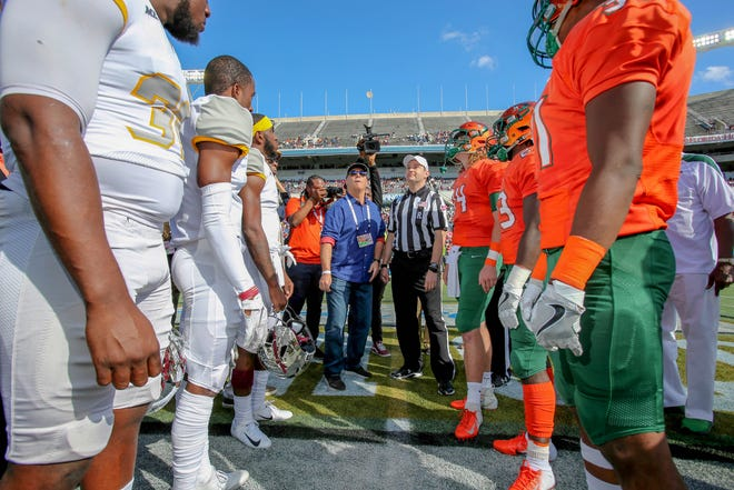 FAMU and Bethune-Cookman meet at midfield for the opening coin toss in the Florida Classic.