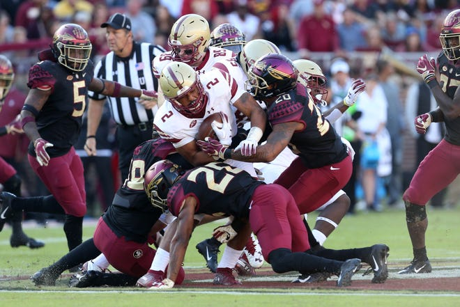 The Seminole defense goes after Boston College Eagles running back AJ Dillon (2) as the Florida State Seminoles face off against the Boston College Eagles at Doak S. Campbell Stadium, Saturday, Nov. 17, 2018.